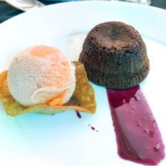chocolate fondant on a blueberry glaze, orange sorbet misted with Shetland Reel Simmer gin